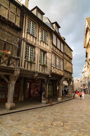 Dinan, Cotes-d-Armor  France - 19 August 2019: tourists enjoy walking around the picturesque and historic old town of Dinan in Brittany