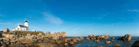 Panorama view of the picturesque white Pontusval lighthouse and bay on the north coast of Brittany in France
