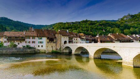 St. Ursanne, Jura  Switzerland - 27 August 2019: the historic and picturesque Swiss village of Saint-Ursanne on the Doubs River
