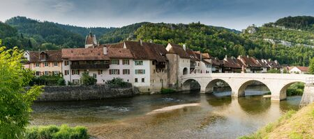 St. Ursanne, Jura  Switzerland - 27 August 2019: panorama of the historic and picturesque Swiss village of Saint-Ursanne on the Doubs River