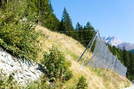 Detail view of strong rock fall safety nets built to protect roads and traffic