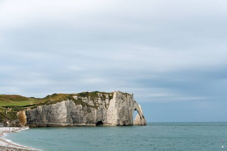 view of the Falaises of Etretat rock cliffs and beach on the coast of Normandy