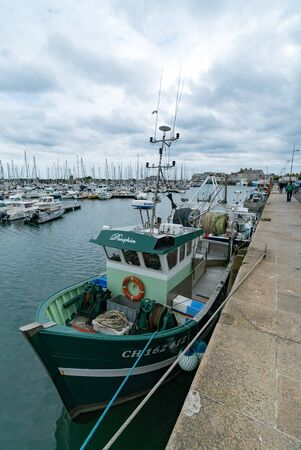 Saint-Vaast-la-Hougue, Manche  France - 16 August, 2019: fishing boats and yacht marina in the harbor of Saint Vaast la Hougue in Normandy