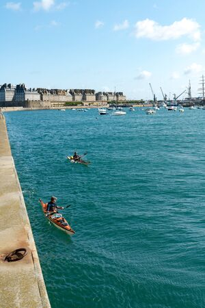 Saint-Malo, Ille-et-Vilaine  France - 19 August 2019: people with sea kayaks leave Saint-Malo for an expedition cruise