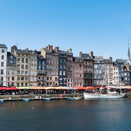Honfleur, Calvados / France - 15 August 2019: fishing boats in the old part and Vieux Bassin district of Honfleur