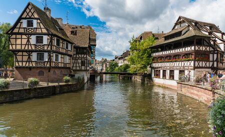 Strasbourg, Bas-Rhin / France - 10 August 2019: the old canals and half-timbered houses in Strasbourg's Petite France neighborhood 에디토리얼