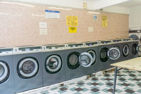Rennes, Ille-et-Vilaine / France - 26 August 2019: interior view of a laundromat in an urban French city