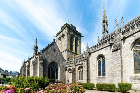 Locronan, Finistere / France - 23 August, 2019: view of the historic and picturesque church of Saint Ronan in Locronan in Brittany