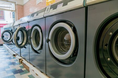 An interior view of a laundromat in an urban French city Stock Photo