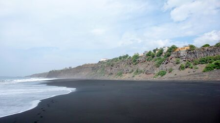 view of black lava sand beach and jagged wild coastline on Fogo Island in Cape Verde Stock Photo