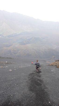 Some hikers descending the Pico de Fogo volcano on Fogo Island in Cape Verde