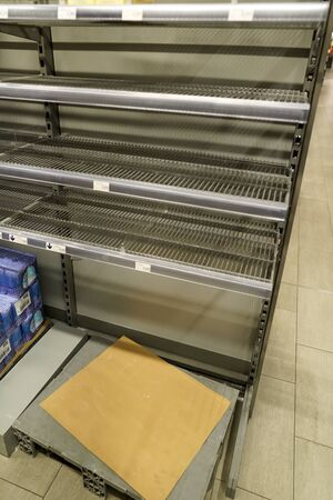 View of empty shelves in a supermarket because of Covid-19 panic shopping