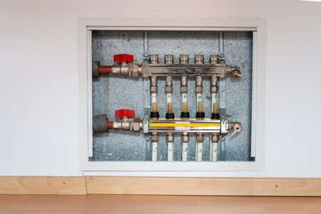 A detailed view of calculating controls and distribution panel für an underfloor heating system Archivio Fotografico