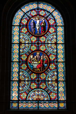 Basel, BL / Switzerland - 8 July 2020: detail view of the stained glass window art inside the cathedral in Basel