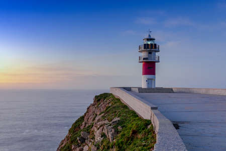 the Cabo Ortegal lighthouse on the coast of Galicia at sunset Stok Fotoğraf