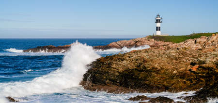 A view of the lighthouse on Isla Pancha in Galicia