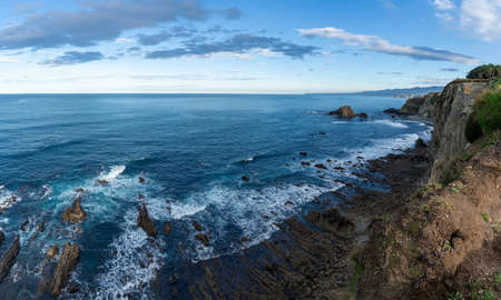 A rugged and wild coastline in northern Spain with cliffs and rocky beach Archivio Fotografico