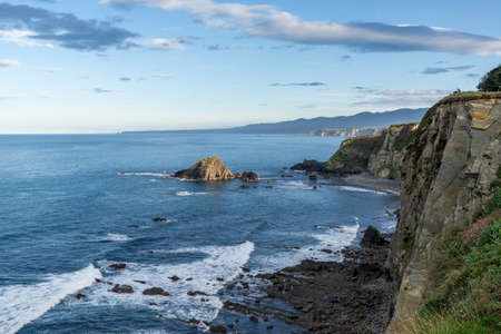 A rugged and wild coastline in northern Spain with cliffs and rocky beach
