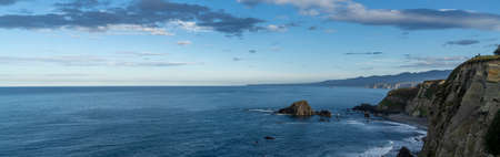 Panorama of a rugged and wild coastline in northern Spain with cliffs and rocky beach