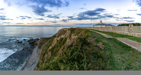 A view of the Cabo de Busto lighthouse at sunset Archivio Fotografico