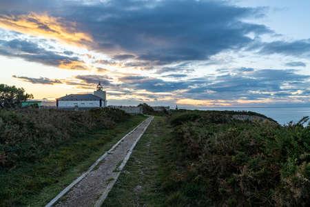 Castañeras, Asturias / Spain - 7 November 2020: view of the Cabo de Busto lighthouse at sunset