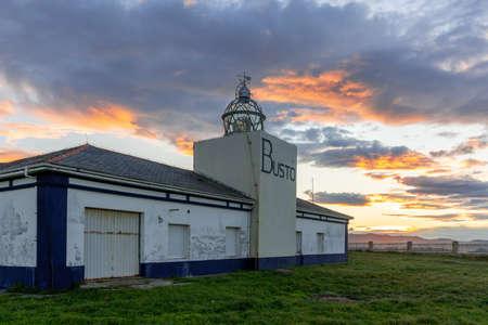 Castañeras, Asturias / Spain - 7 November 2020: view of the Cabo de Busto lighthouse at sunset Editoriali