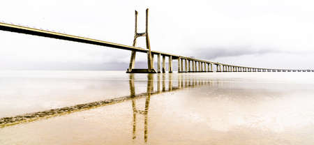 A high key panorama view of the Bridge in Lisbon 免版税图像