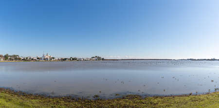 A panorama view of Donana National Park wetlands and El Rocio village and church in the background