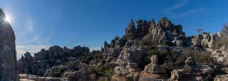 A panorama view of the El Torcal Nature Reserve in Andalusia with ist strange karst rock formations with a sun star Stock fotó