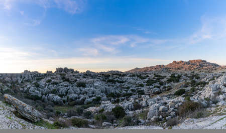 A panorama view of the El Torcal Nature Reserve in Andalusia with ist strange karst rock formations at sunset