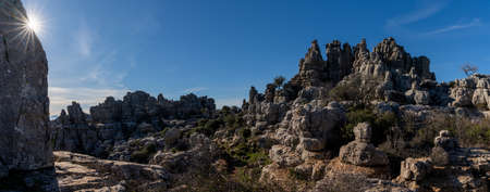 A panorama view of the El Torcal Nature Reserve in Andalusia with ist strange karst rock formations with a sun star