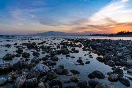 A colorful sunset on the Mediterranean Sea in Almeria with rocks and tidal pools in the foreground Reklamní fotografie