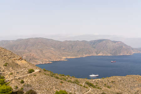 A view of the Sierra de Muela mountains and the Bay of Cartagena in Murcia with moored freight ships at anchor Reklamní fotografie