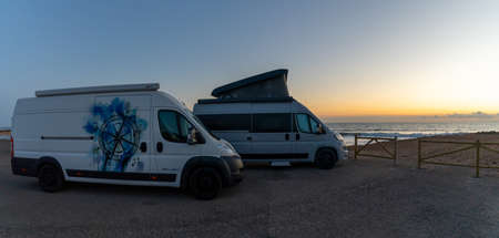 La Manga del Mar Menor, 22 February, 2021: beautiful sunrise with two camper vans parked at the beach
