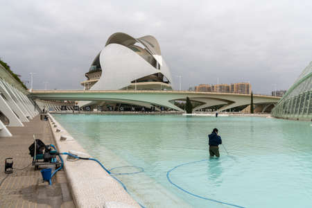 Valencia, Spain - 3 March, 2021: city workers cleaning the pools in the City of Arts and Sciences in Valencia