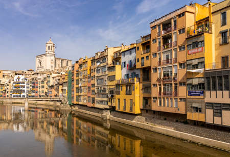 Girona, Spain - 11 March, 2021: the historic old city center of Girona in northern Spain with ist many colorful buildings along the banks of the Onyar River