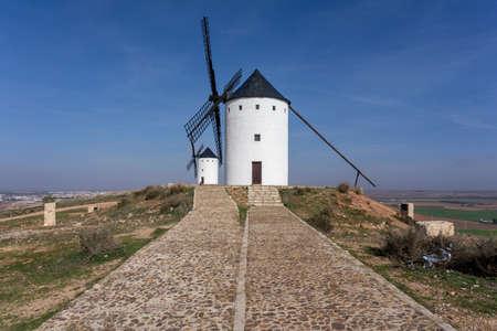 View of the historic the windmills of La Mancha in the hills above San Juan de Alcazar