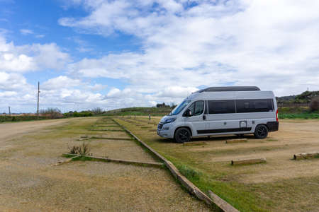Carcassonne, France - 14 March, 2021: gray camper van parked in an empty parking lot 新闻类图片