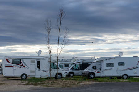 Le Barcares, France - 13 March, 2021: many camper vans and RVs parked in the RV Park in the harbor at Port Barcares under an overcast sky