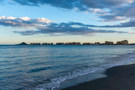 The seashore of La Manga del Mar Menor with ist many hotels and beaches at sunset under an expressive sky Stock fotó