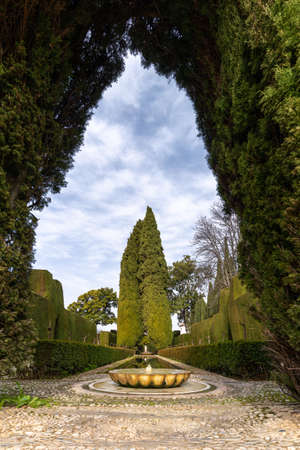 Granada, Spain - 5 February, 2021: the Patio de la Acequia in the Generalife Palace Grounds in Granada