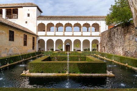 Granada, Spain - 5 February, 2021: the Patio de los Cipreses in the Generalife Palace in the Alhambra in Granada 新闻类图片