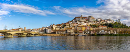 Coimbra, Portugal: 8 December 2020: panorama view of the old town of Coimbra in Portugal with river in the foreground 新闻类图片