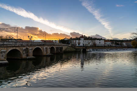 Tomar, Portugal: 8 December 2020: the beautiful old city center of Tomar in Portugal at sunset 新闻类图片