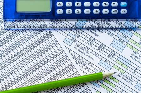 Calculator, pencil and data sheet photo
