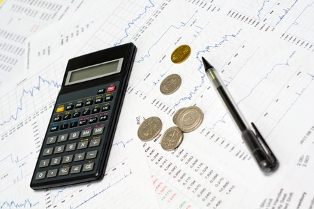 Calculator and coin photo