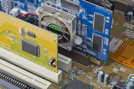 Computer motherboard with pluged components. VGA and PCI card. Stock Photo