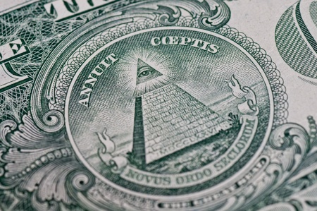 The pyramid and eye on the back of a one dollar bill. photo