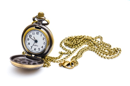 Old beautiful pocket watch. Isolated on white background. photo