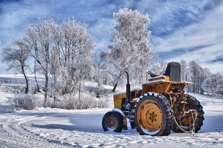 Winter sceneries in Lithuania, old tractor under the snow photo